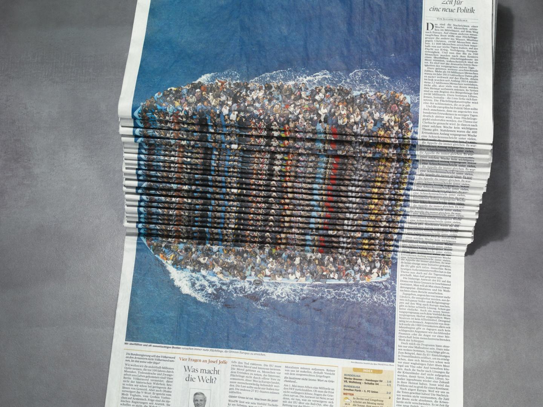 Image for Newspaper Stack - Refugees